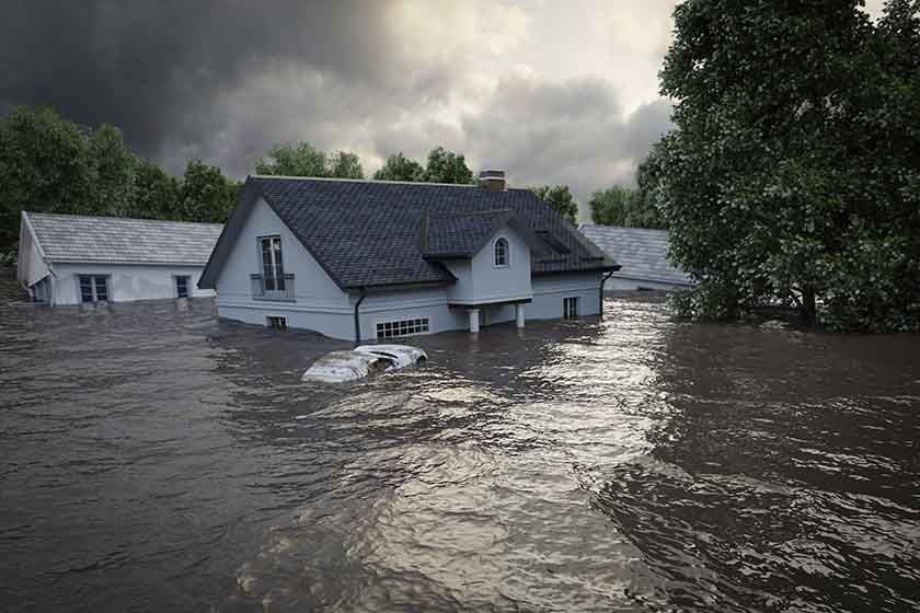 Flood insurance advice from Lenders to Borrowers image of house in flooded